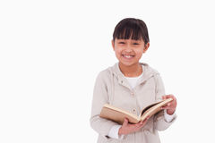 Smiling girl reading a book Royalty Free Stock Photography