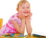 Smiling girl reading the book Stock Photo