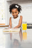 Smiling girl reading a book Royalty Free Stock Image