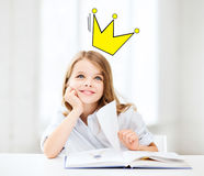 Smiling girl reading fairytales at home Royalty Free Stock Photos