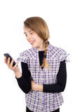 Smiling Girl Reading Funny Message on Her Mobile Phone Isolated on White Stock Photos