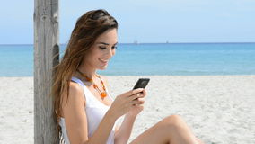 Smiling Girl Reading sms at sea stock footage