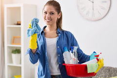 Smiling girl ready for cleaning Stock Photos