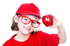 Smiling girl with red apple Stock Photography