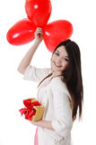 Smiling girl with red balloons and gift Stock Photo