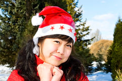 Smiling girl in red cap Stock Photography