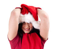 Smiling girl in red Christmas hat Stock Image