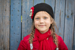 Smiling girl in red royalty free stock image
