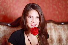 Smiling girl with red rose Royalty Free Stock Photography