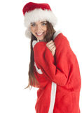Smiling girl in red Santa clothes and hat Royalty Free Stock Photography