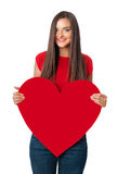 Smiling  girl in red shirt with big red heart Royalty Free Stock Images