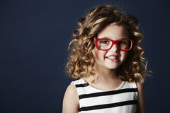 Smiling girl in red spectacles Stock Images