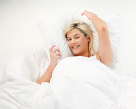 Smiling girl resting in bed Stock Image