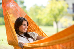 Smiling girl resting in hammock Stock Photos