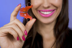 Smiling girl with retainer on teeth Stock Image