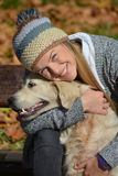 Smiling girl and retriever Royalty Free Stock Image