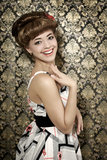 Smiling girl with retro hairstyle Royalty Free Stock Images