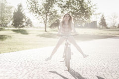 Smiling girl riding on bicycle Stock Photo