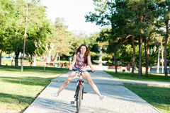 Smiling girl riding on bicycle Royalty Free Stock Images