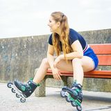 Smiling girl with roller skates outdoor stock photography