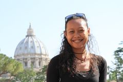Smiling girl with roof of St. Peter`s Basilica Stock Images
