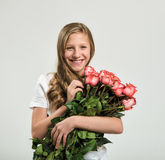 Smiling girl with roses bouquet Stock Image