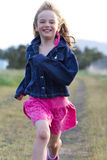 Smiling girl running Royalty Free Stock Images