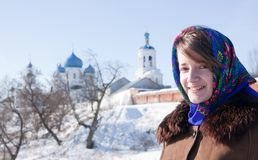 Smiling girl in russian traditional kerchief Stock Images