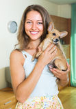 Smiling girl with Russkiy Toy Terrier Royalty Free Stock Images