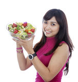 Smiling girl with salad Royalty Free Stock Photography
