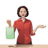 Smiling girl sales clerk holding a shopping bag and offers products Royalty Free Stock Image