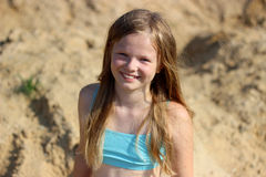 Smiling girl on sand Royalty Free Stock Photos