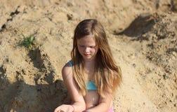 Smiling girl on sand Stock Image