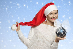 Smiling girl with santa claus hat Stock Image