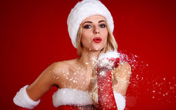 Smiling girl in santa clause costume Royalty Free Stock Images