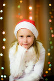 Smiling girl in santa hat Stock Photos