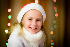 Smiling girl in santa hat Royalty Free Stock Images