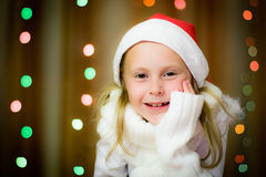 Smiling girl in santa hat Royalty Free Stock Photography
