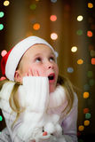 Smiling girl in santa hat Royalty Free Stock Image