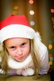 Smiling girl in santa hat Stock Photos