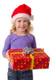 Smiling girl in Santa hat with gift box Stock Image