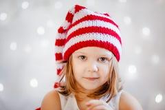 Smiling girl in Santa hat Stock Photo
