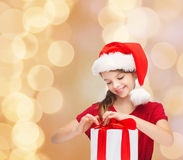 Smiling girl in santa helper hat with gift box Stock Photography
