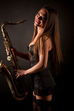 Smiling girl with sax Royalty Free Stock Image