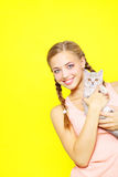 Smiling girl with Scottish Straight Royalty Free Stock Photos
