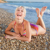 Smiling girl at sea Stock Photos