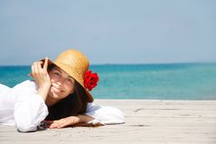 Smiling girl on sea background Stock Photos