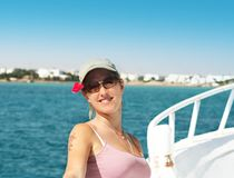 Smiling Girl At Sea Travel. Beautyful smiling girl at the stern of the boat in Elguna, Egypt Royalty Free Stock Image