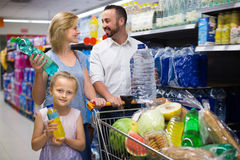 Smiling girl selecting non-alcoholic beverage Stock Photos