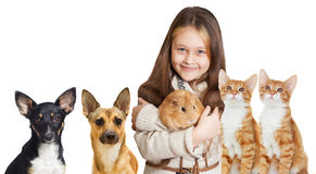 Smiling girl and a set of pets. On a white background isolated Stock Images